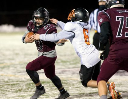 Torrington's Joshua Maldonado (23) breaks free from Watertown's Nicholas Graziano (6), to run for a first down during their annual match--up Wednesday at Torrington High School. Jim Shannon Republican American