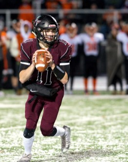 Torrington's Ora Curry (11) can't find an open reciever during their annual match--up with Watertown so he ran it in for an 18-yard touchdown run Wednesday at Torrington High School. Jim Shannon Republican American