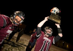 "Torrington senior Ora Curry (11) hoists ""The Helmet"" trophy while teammate Xavier Francis (1) looks on, following their 37-20 win over Watertown Wednesday at Torrington High School. Jim Shannon Republican American"
