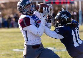 Naugatuck's Zack Koslosky #9 catches the ball against Ansonia's Jalen Johnson #10 defending during a NVL clash of unbeatens and the annual Thanksgiving Day game between Naugatuck and Ansonia at Jarvis Stadium at the Nolan Field Athletic Complex in Ansonia on Thursday. Bill Shettle Republican-American