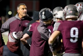 Naugatuck head coach Dave Sollazzo talks with his players during a time-out during their Class L quarterfinal game against Platt Tuesday at Naugatuck High School. Jim Shannon Republican American