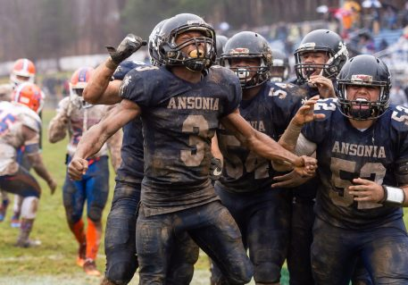 Ansonia running back Shykeem Harmon #3 celebrates his touchdown with his teammates surrounding him during the Class S Semi-final game between Bloomfield and Ansonia at Ansonia High School in Ansonia on Sunday. Bloomfield held on to beat Ansonia 26-19 and advances to the Class S Championship game next week. Bill Shettle Republican-American