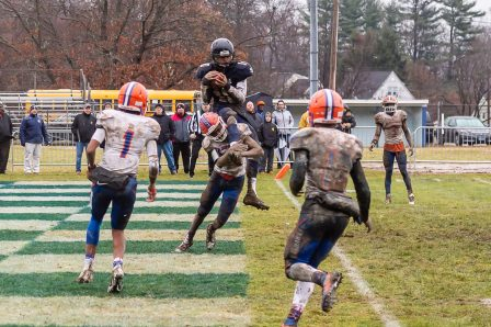 Ansonia's Jalen Johnson #10 scores a touchdown on top of the shoulders of Bloomfield's Michael Raiford #6, very late in the fourth quarter during the Class S Semi-final game between Bloomfield and Ansonia at Ansonia High School in Ansonia on Sunday. Bloomfield held on to beat Ansonia 26-19 and advances to the Class S Championship game next week. Bill Shettle Republican-American