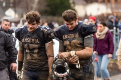Ansonia players and brothers Tyler Cafaro #17 and Garrett Cafaro #86 walk off the field together disappointed after getting beat by Bloomfield 26-19 during the Class S Semi-final game between Bloomfield and Ansonia at Ansonia High School in Ansonia on Sunday. Bill Shettle Republican-American