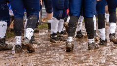 Ansonia players stand in the mud along their sidelines during the Class S Semi-final game between Bloomfield and Ansonia at Ansonia High School in Ansonia on Sunday. Bloomfield held on to beat Ansonia 26-19 and advances to the Class S Championship game next week. Bill Shettle Republican-American