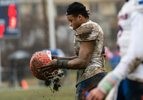 Bloomfield's Ky'Juon Butler #45 tries to shake out the mud from his helmet during the Class S Semi-final game between Bloomfield and Ansonia at Ansonia High School in Ansonia on Sunday. Bloomfield held on to beat Ansonia 26-19 and advances to the Class S Championship game next week. Bill Shettle Republican-American