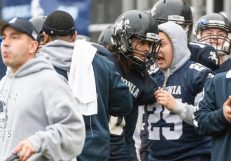 Injured Ansonia player Darwin Amaya #25 gives some advice to Ansonia's Jalen Johnson #10 along the sidelines during the Class S Semi-final game between Bloomfield and Ansonia at Ansonia High School in Ansonia on Sunday. Bloomfield held on to beat Ansonia 26-19 and advances to the Class S Championship game next week. Bill Shettle Republican-American