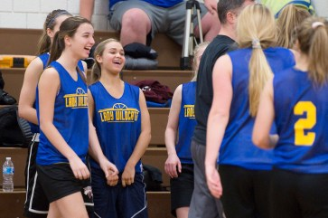 Seymour's Alyssa Cosciello (34), second from left, shares a laugh with teammates during a time out in their scrimmage against Nonnewaug. (Jim Shannon /RA)