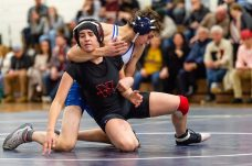 Nonnewaug's Benjamin Niez-Charest has a tight hold around Northwestern's Lily Schwartz in the 145 lb class during a wrestling match between Northwestern Regional and Nonnewaug at Nonnewaug High School in Woodbury on Wednesday. Bill Shettle Republican-American
