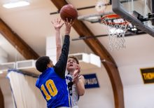 Housatonic's Evan Miller #10 lays the ball up against Litchfield's Evan Fischthal #22 during a BL Boys basketball game between Housatonic Valley ad Litchfield at Litchfield High School in Litchfield on Thursday. Bill Shettle Republican-American