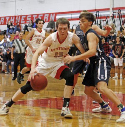Northwestern's Owen Maltby (13) drives to the hoop as Shepaug's Owen Hibbard (5) defends Friday night at Northwestern Regional High School. Michael Kabelka / Republican-American
