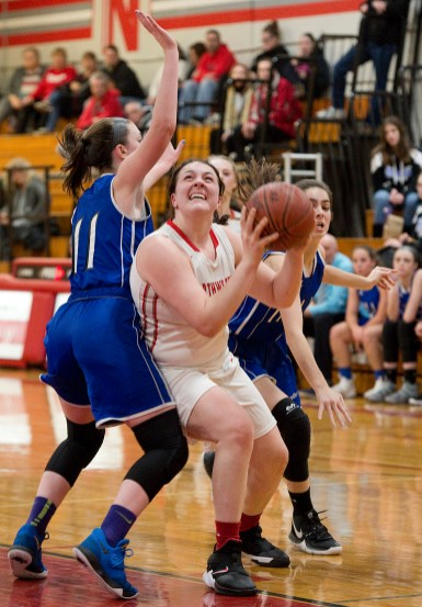 Northwestern's Natalie Lederman (22) puts up a shot in front of Lewis Mills' Emily Hunt (11) during their game Tuesday at Northwestern Regional High School. Jim Shannon Republican American