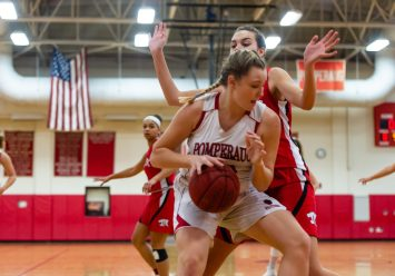 Pomperaug's Jada Stietzel #21 dribbles down low against Masuk's Emily Rentz #40 during a SWC Girls Basketball game between Masuk and Pomperaug at Pomperaug High School in Southbury on Friday. Bill Shettle Republican-American