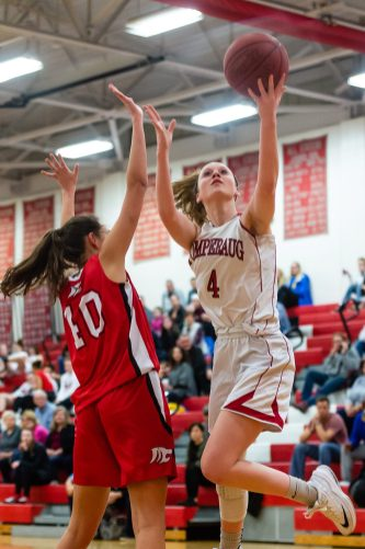 Pomperaug's Cara McGettigan #4 lays the ball up for an easy basket against Masuk's Emily Rentz #40 defending during a SWC Girls Basketball game between Masuk and Pomperaug at Pomperaug High School in Southbury on Friday. Bill Shettle Republican-American