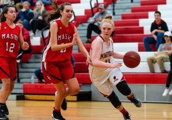 Pomperaug's Maggie Lee #33 dribbles down the baseline past Masuk's Emily Rentz #40 during a SWC Girls Basketball game between Masuk and Pomperaug at Pomperaug High School in Southbury on Friday. Bill Shettle Republican-American