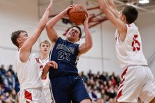 Shepaug's Joseph Brunelli #23 drives down the lane to the basket against Wamogo's Sean Coffey #3, left, and Matt Mazzarelli #15 during a BL basketball game in the Litchfield Hills Holiday Claasic between Shepaug and Wamogo at Wamogo High School in Litchfield on Thursday. Bill Shettle Republican-American