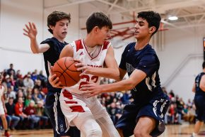 Shepaug's Tiernan Crossley, left and Dominic Perachi #21, surround Wamogo's Eric Odenwaelder #22, trying to get to the ball during a BL basketball game in the Litchfield Hills Holiday Claasic between Shepaug and Wamogo at Wamogo High School in Litchfield on Thursday. Bill Shettle Republican-American