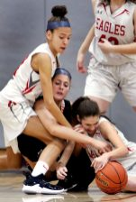 #5 Jordyn Forte of Watertown High battles for the loose ball with #21 Ella Vaughn and #15 Allie LeClerc of Wolcott High during basketball action in Wolcott Thursday. Steven Valenti Republican-American