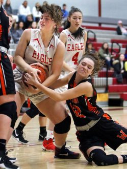 #42 Adrianna Ferrucci of Wolcott High and #12 Nicole DeFeo of Watertown High battle for the loose ball during basketball action in Wolcott Thursday. Steven Valenti Republican-American