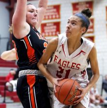 #21 Ella Vaughn of Wolcott High look to go up for a shot as #24 Emily Deptula of Watertown High defends during basketball action in Wolcott Thursday. Steven Valenti Republican-American