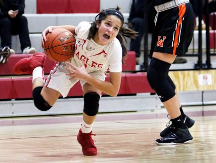 #1 Emiyah Soto of Wolcott High looses her footing after dribbling past #5 Jordyn Forte of Watertown High during basketball action in Wolcott Thursday. Steven Valenti Republican-American