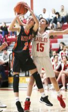 #2 Kristina Kyle of Watertown High puts up a shot against #15 Allie LeClerc of Wolcott High during basketball action in Wolcott Thursday. Steven Valenti Republican-American
