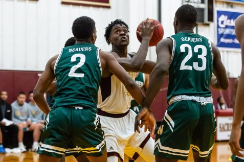 Sacred Heart's Jamaal Waters #11 drives to the basket against Weaver defenders Ta 'Ki Blizzard #2, left, and Tristan Reid #23 during a non-league intersectional basketball game betwwen Weaver and Sacred Heart at Sacred Heart High School in Waterbury on Friday. Bill Shettle Republican-American