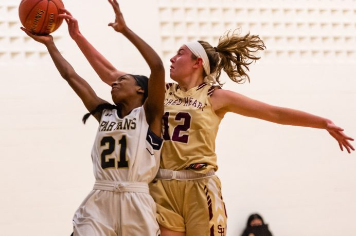 Sacred Heart's Hayley Tucker #12 blocks the shot of WCA's Jonna Pierre #21 during a NVL Girls Basketball game between Sacred Heart and WCA at the Waterbury Career Academy in Waterbury on Thursday. Sacred Heart ending up beating a pesky WCA team 43-31. Bill Shettle Republican-American