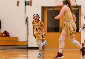 Sacred Heart's Mikayla Mobley #13 reacts after scoring a basket late in the NVL Girls Basketball game between Sacred Heart and WCA at the Waterbury Career Academy in Waterbury on Thursday. Sacred Heart ending up beating a pesky WCA team 43-31. Bill Shettle Republican-American
