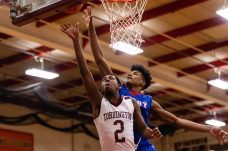 Torrington's Tyreek Davis #2 gets to the basket in front of Crosby's Kerwin Prince #0 defending during a NVL Boys Basketball game between Crosby and Torrington at Torrington High School in Torrington on Wednesday. Bill Shettle Republican-American