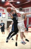 Oxford High School's Hunter Keller goes up for a shot over Wolcott High School's Jack Drewry during the varsity basketball game in Wolcott on Wednesday night. Emily J. Reynolds. Republican-American