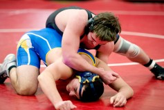 Pomperaug's Harrison Anglace tries to break down Newtown's Justin Bogdanoff as they compete in the 182 lb. class during their meet Thursday at Pomperaug High School in Southbury. Jim Shannon Republican American