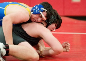 Pomperaug's Sam Mathena, right, tries to get out of the grasp of Newtown's Sebastian Vona as they compete in the 195 lb. class during their meet Thursday at Pomperaug High School in Southbury. Jim Shannon Republican American