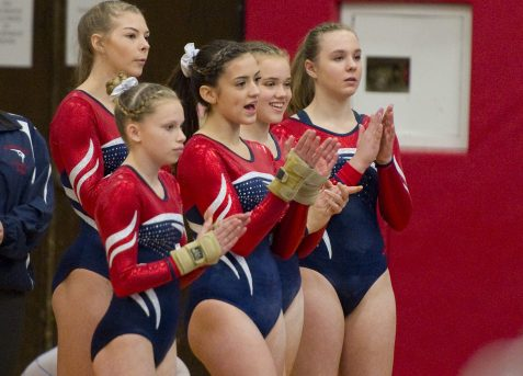Members of the Nonnewaug gymnastics team, applaud their teammate during the floor exercise during the Pomperaug Invitational gymnastics meet held Saturday at Pomperaug High School. Jim Shannon Republican American