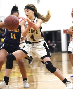 #4 Antia Ozuna of Kaynor Tech. drives past #11 Shyan Perez of Kennedy High during basketball action in Waterbury Monday. Steven Valenti Republican-American