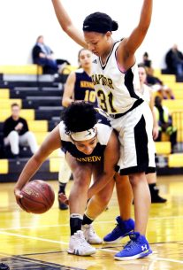 #22 Aniyyah Watson of Kennedy High tries to control the rebound as #31 Se Reiya Steward of Kaynot Tech. defends during basketball action in Waterbury Monday. Steven Valenti Republican-American
