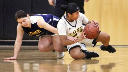 #21 Phoebe Cassette of Kennedy High and #23 Bernie Hernandez of Kaynor Tech. battle for the loose ball during basketball action in Waterbury Monday. Steven Valenti Republican-American