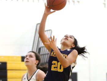 #20 Amaryllies Rivera of Kennedy puts up a shot over #10 Danielle Salvati of Kaynor Tech. during basketball action in Waterbury Monday. Steven Valenti Republican-American