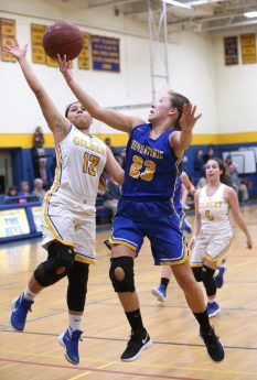 WINSTED CT. 09 January 2019-010819ER01-Housatonic Regional High School's Christina Winburn goes up for a shot over Gilbert High School's Marcela Moreira during the girls varsity basketball game on Tuesday night. Emily J. Reynolds. Republican-American