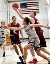 #33 Kai Kostmayer of Taft goes to the basket as #22 Jorge Paya of Kent defends during basketball action in Watertown Wednesday. Steven Valenti Republican-American