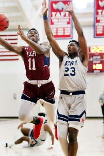 #11 Skylar Bell of Taft puts up a shot over #23 Phil Dawson of Kent during basketball action in Watertown Wednesday. Steven Valenti Republican-American