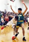 #13 Omar Rowe of Sacred Heart drives to the hoop as #2 Akili Evans of Holy Cross defends during 2nd quarter basketball action in Waterbury Thursday. Steven Valenti Republican-American