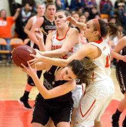 Thomaston's Sydney Stevenson (2) battles for a rebound with Terryville's Tiffany Pires (15) and Jordan Conklin (11) during their Berkshire League match up Friday at Terryville High School. Jim Shannon Republican American