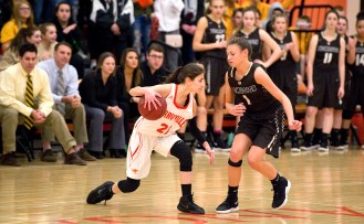 Terryville's Amy Roqi (21) looks to run past Thomaston's Emma Kahn(1) during their Berkshire League match up Friday at Terryville High School. Jim Shannon Republican American