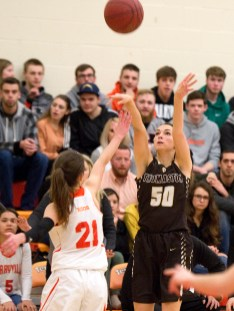 Thomaston's Megan Guay (50) puts up a three-point shot over Terryville's Amy Roqi (21) during their Berkshire League match up Friday at Terryville High School. Jim Shannon Republican American
