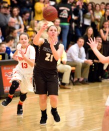Thomaston's Emily Root (21) dishes off the ball after getting past Terryville's Alivia Cote (13) during their Berkshire League match up Friday at Terryville High School. Jim Shannon Republican American