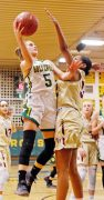 Holy Cross' Allie Brown (#5) puts up a shot as Sacred Heart's Nevaeh Jones (#32) defends Friday night during NVL action at Holy Cross High School. Michael Kabelka / Republican-American