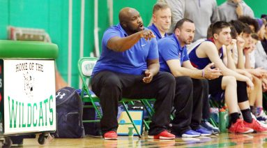 Former Wilby High player Devonne Parker, Nonnewaug High Coach, on the bench during basketball action in Waterbury Monday. Steven Valenti Republican-American