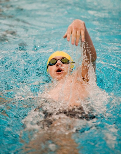 Wilby-Kaynor's Eldin Bukalo competes in the 100m backstroke during their meet Tuesday with Wilby-Kaynor at Watertown High School. Jim Shannon Republican American