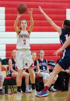 Pomperaug's Alex Rafferty (2) puts up a three point shot over the outstretched arm of New Fairfield's Allison Teklits (10) during their SWC game Tuesday at Pomperaug High School. Jim Shannon Republican American